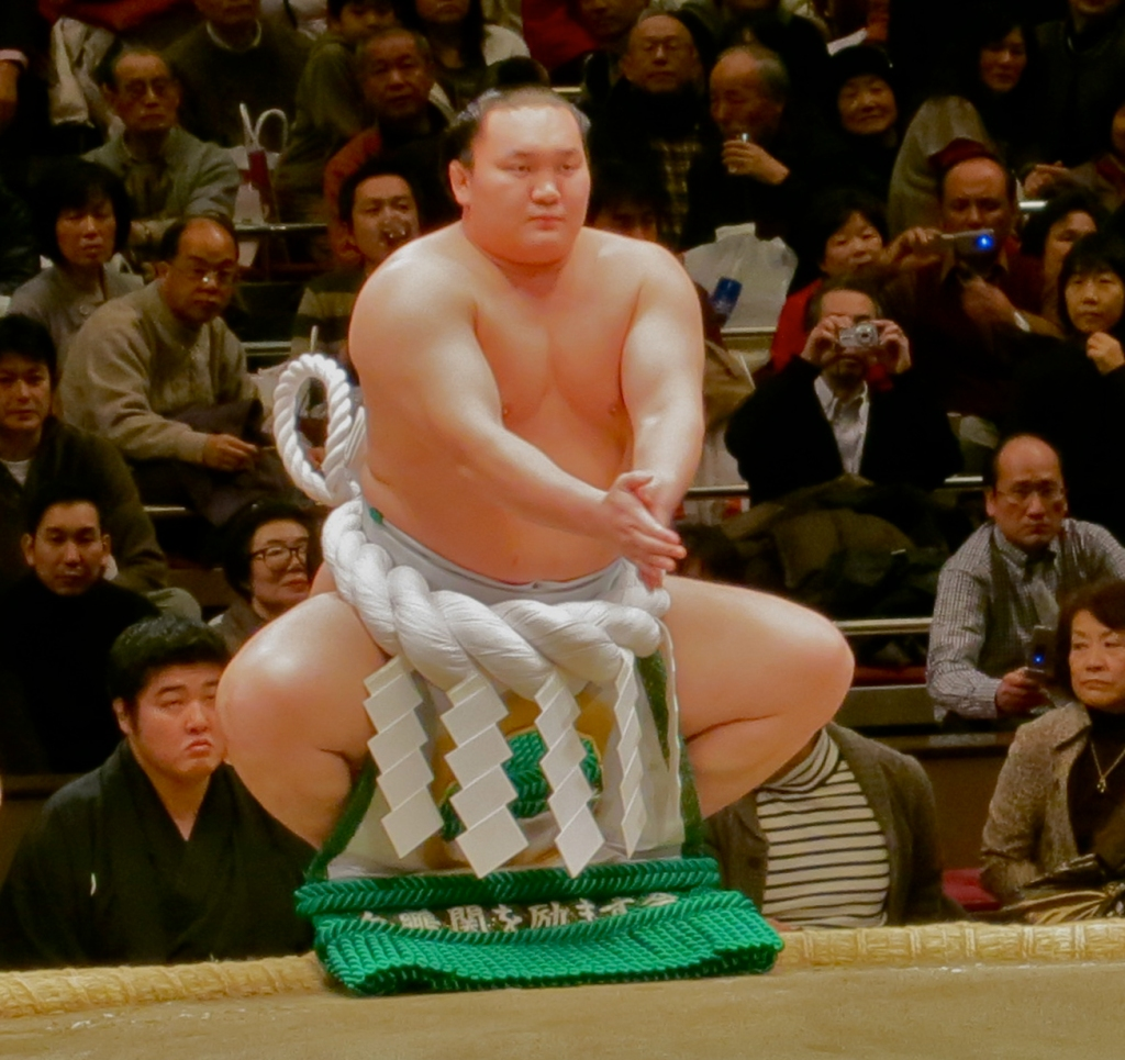 Sumo wrestler Asashoryu yokozuna doing kata in the ring