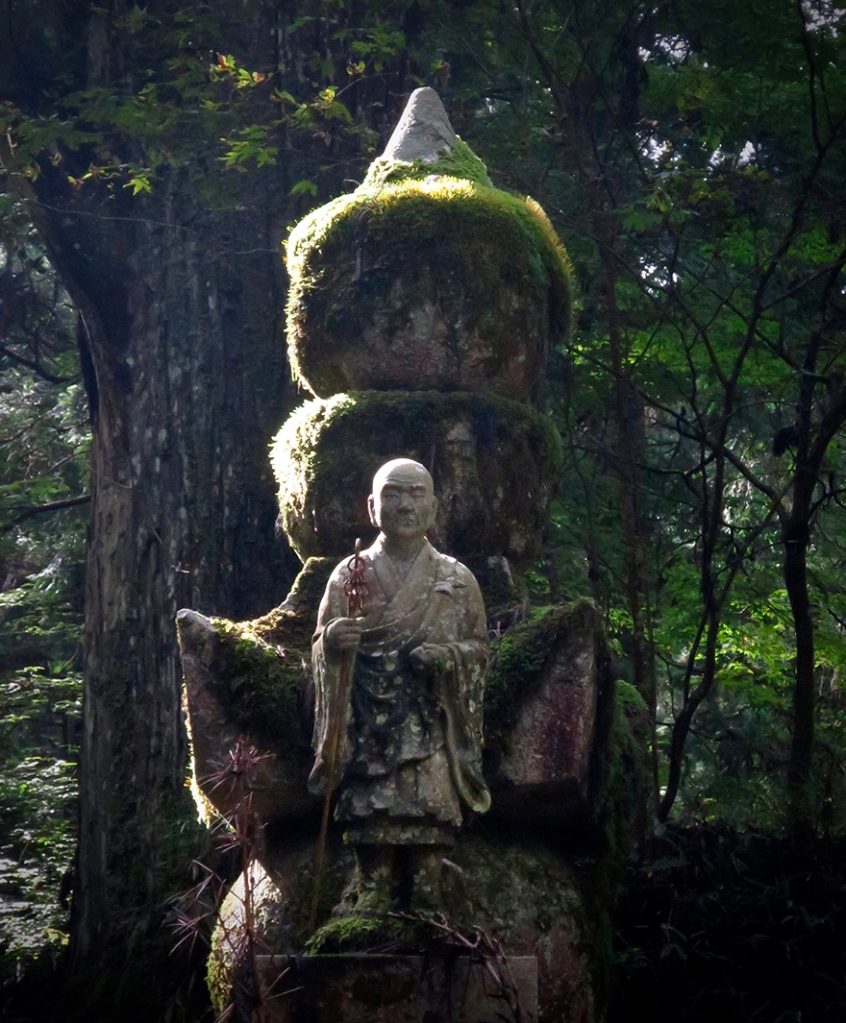 Mossy statue of Kobo Daishi (Kukai) at Koya-san in Japan