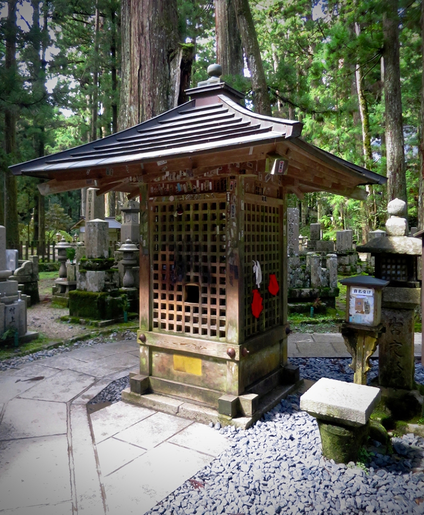 Wooden booth housing the test for pure heart stone in Koya-san graveyard