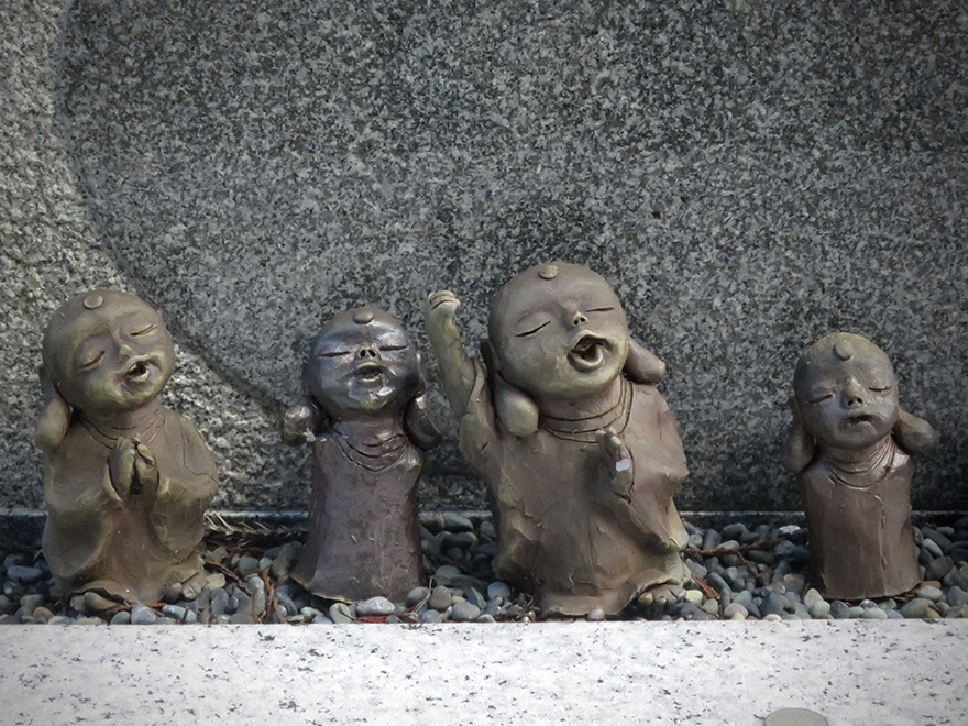 Small joyful Jizo figures in Koya-san graveyard