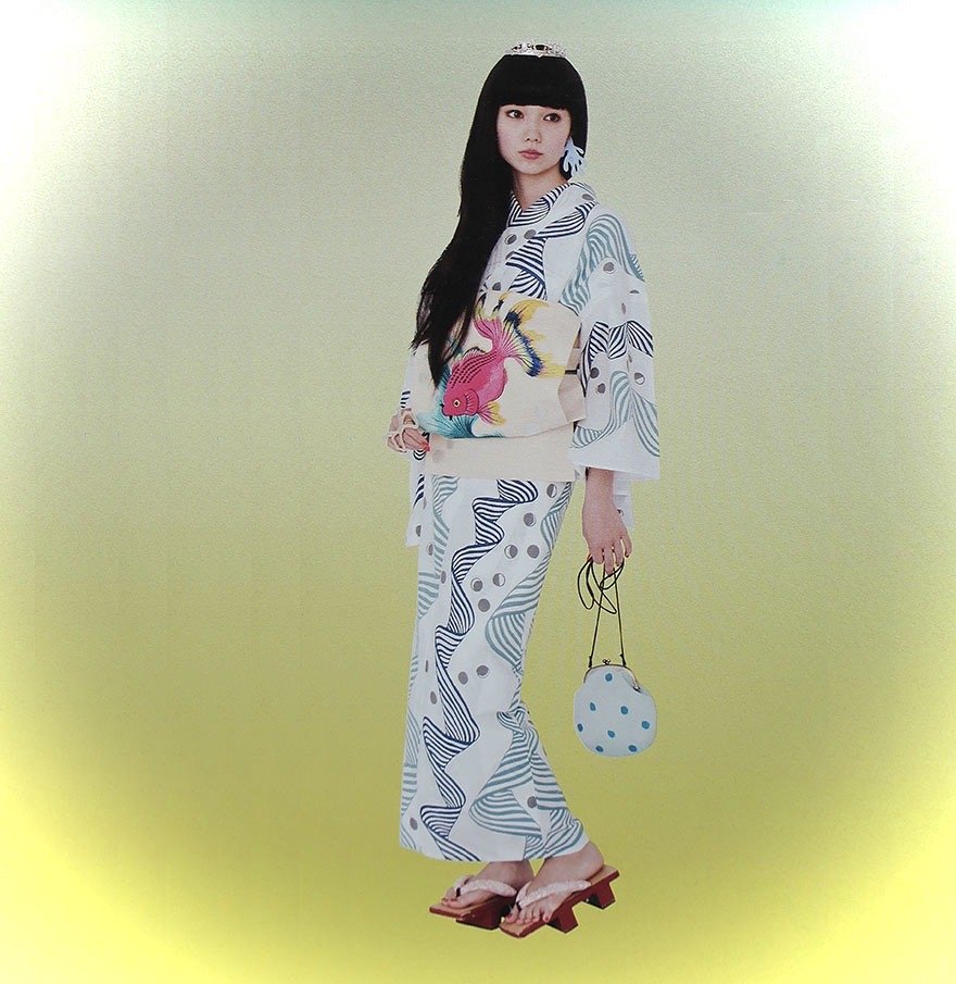 Young Japanese woman wearing summer yukata from Kimono Hime magazine