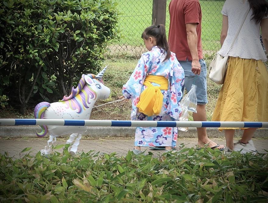 Small girl in yukata with unicorn balloon at the Edogawa Goldfish Festival