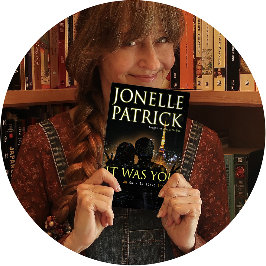 Author Jonelle Patrick with signed paperback book giveaway It Was You