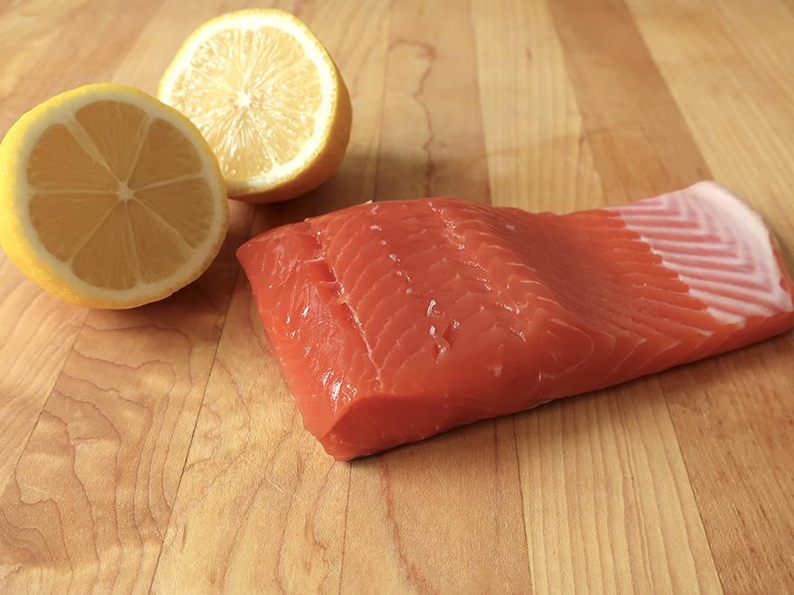 Salmon fillet with cut lemon