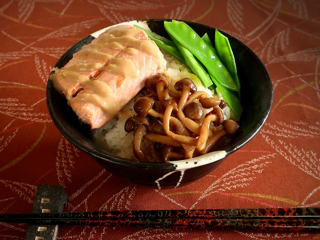 Japanese rice bowl with miso-sauced poached salmon, peppery marinated mushrooms and snow peas with soy-lemon dressing