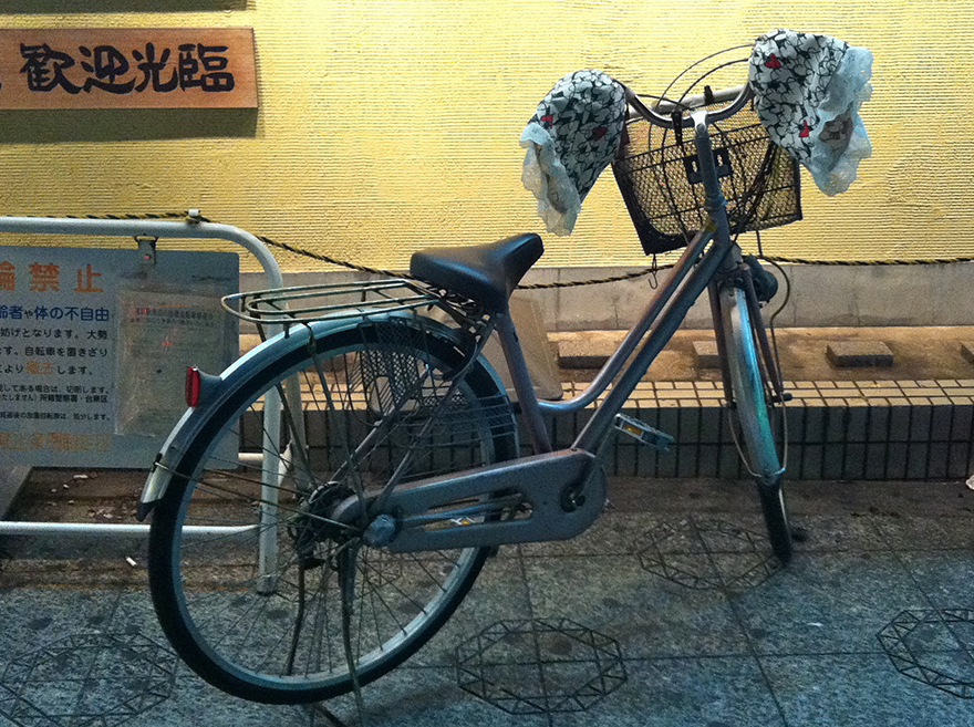 Japanese bicycle with frilly hand protectors on handlebars