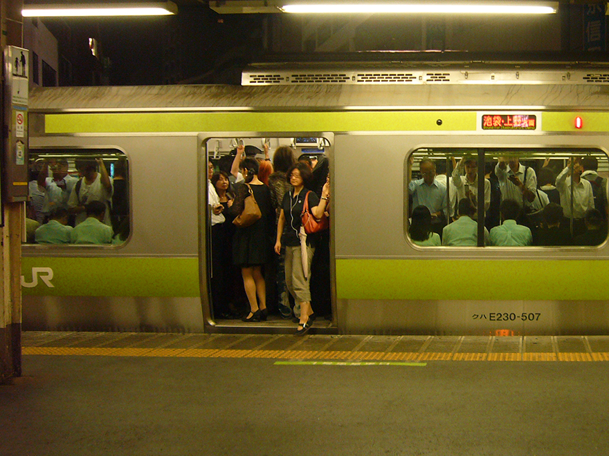 Packed Yamanote Line train waiting at the platform