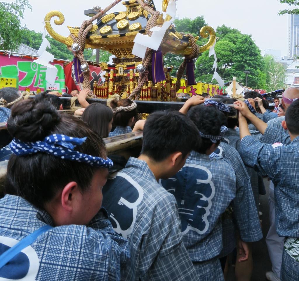 Team carrying o-mikoshi portable shrine at Sanja matsuri in Asakusa Tokyo