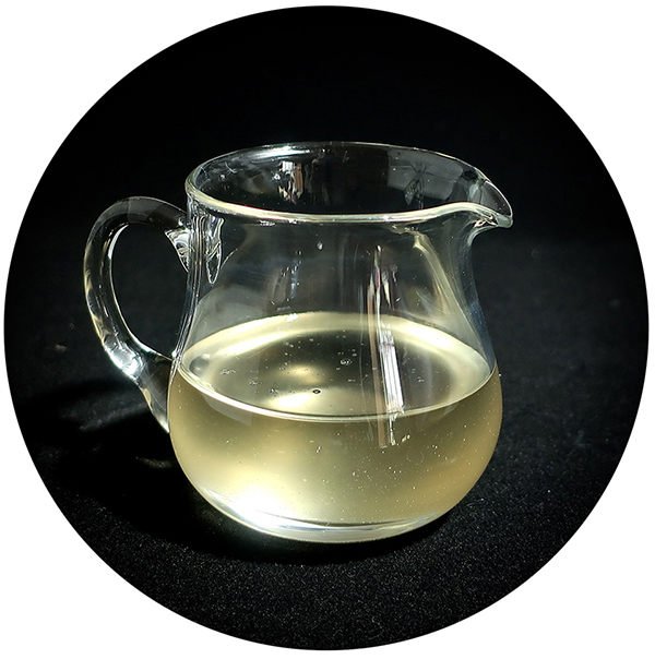 Ginger simple syrup in clear pitcher