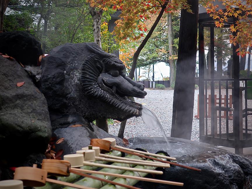 Steam-breathing stone dragon at Suwa Taisha Akimiya in Suwa City Nagano