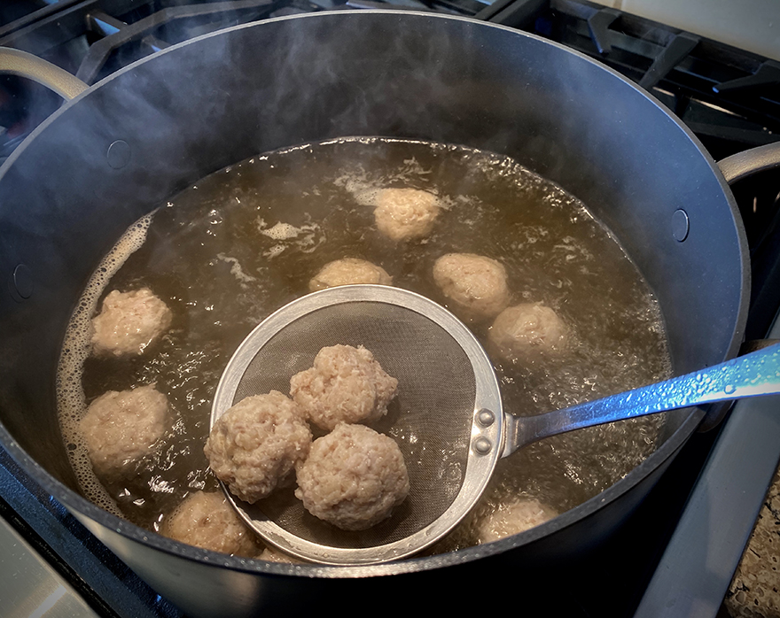 Chicken meatball tsukune boiling in pot