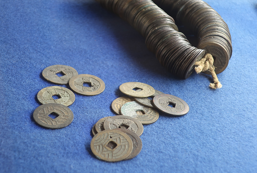String of Edo Period coins at the Nomura Samurai Residence in Kanazawa