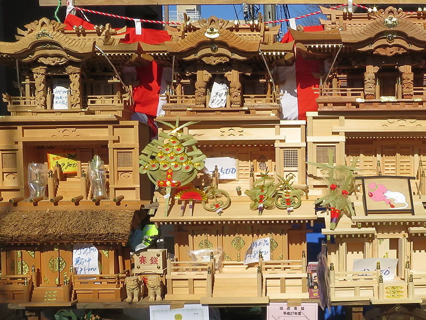 Shrines carved from Yakushima cedar being sold at the Setagaya Boroichi flea market in Tokyo