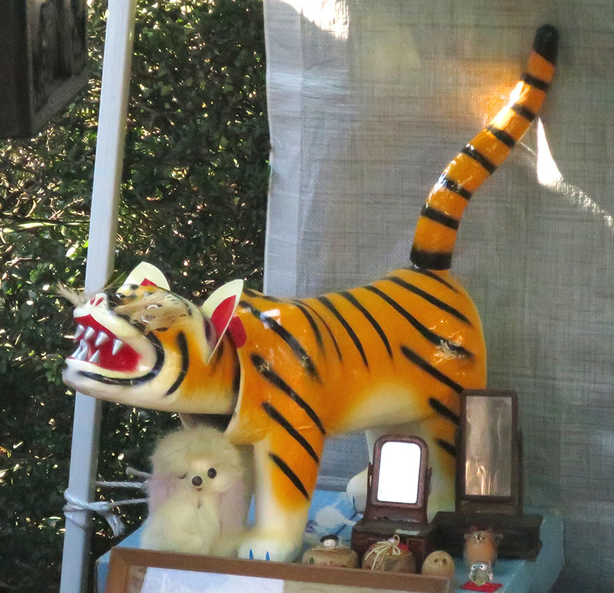Bobble-hear tiger being sold at the Setagaya Boroichi flea market in Tokyo