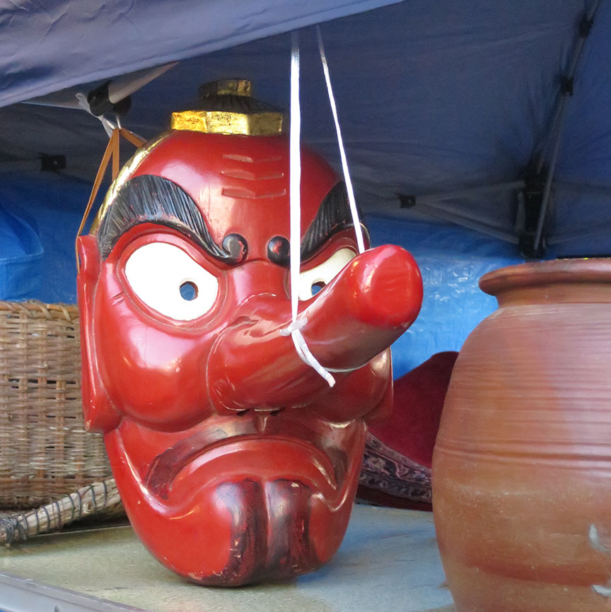 Carved wooden tengu mask being sold at the Setagaya Boroichi flea market in Tokyo