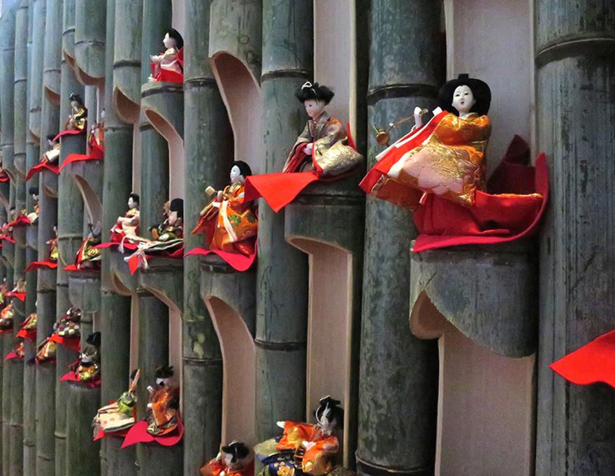 Katsuura Doll Festival hina matsuri thousands of dolls on bamboo display wall