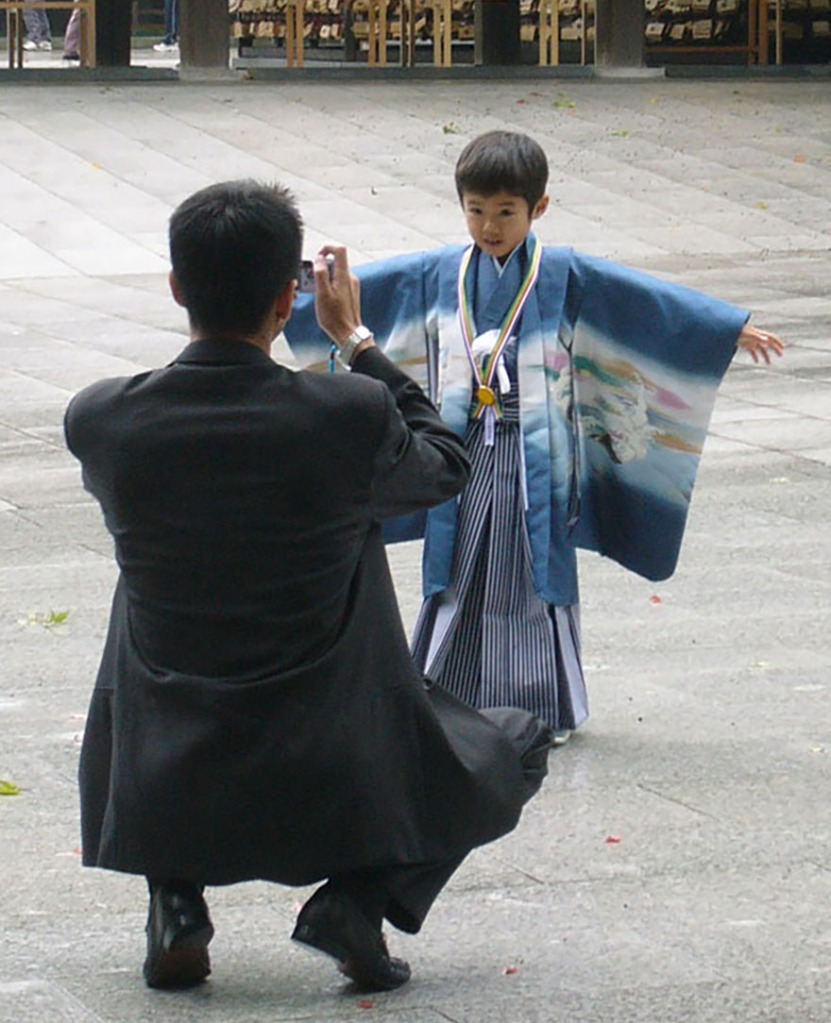 Little boy dressed in hakama and haori on Coming-of-age Day at the Meiji Shrine