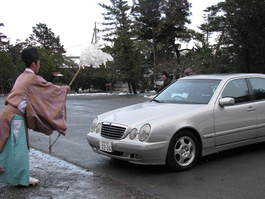 Shinto priest blessing car