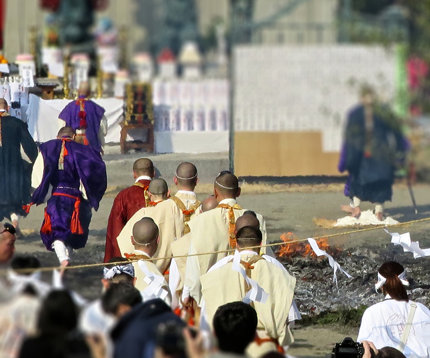 Priests walking across hot coals at the Hiwatari firewalking festival near Mt. Takao