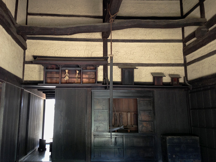 Interior of a thatch-roofed farmhouse at the Nihon Minka-en Japanese Folk House Garden