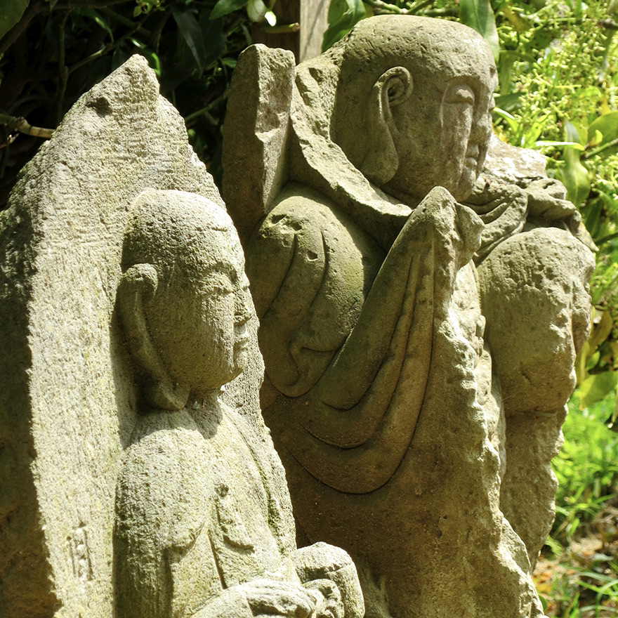 Stone Jizo figures at the Nihon Minka-en Japanese Folk House Garden