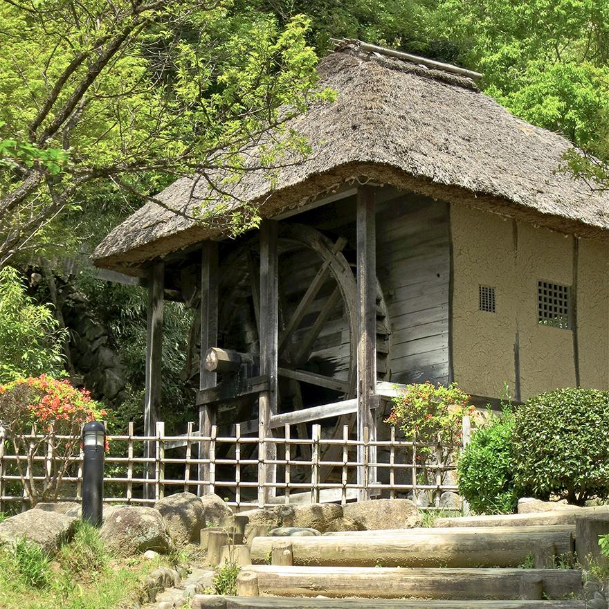 Thatch-roofed soba mill at the Nihon Minka-en Japanese Folk House Garden