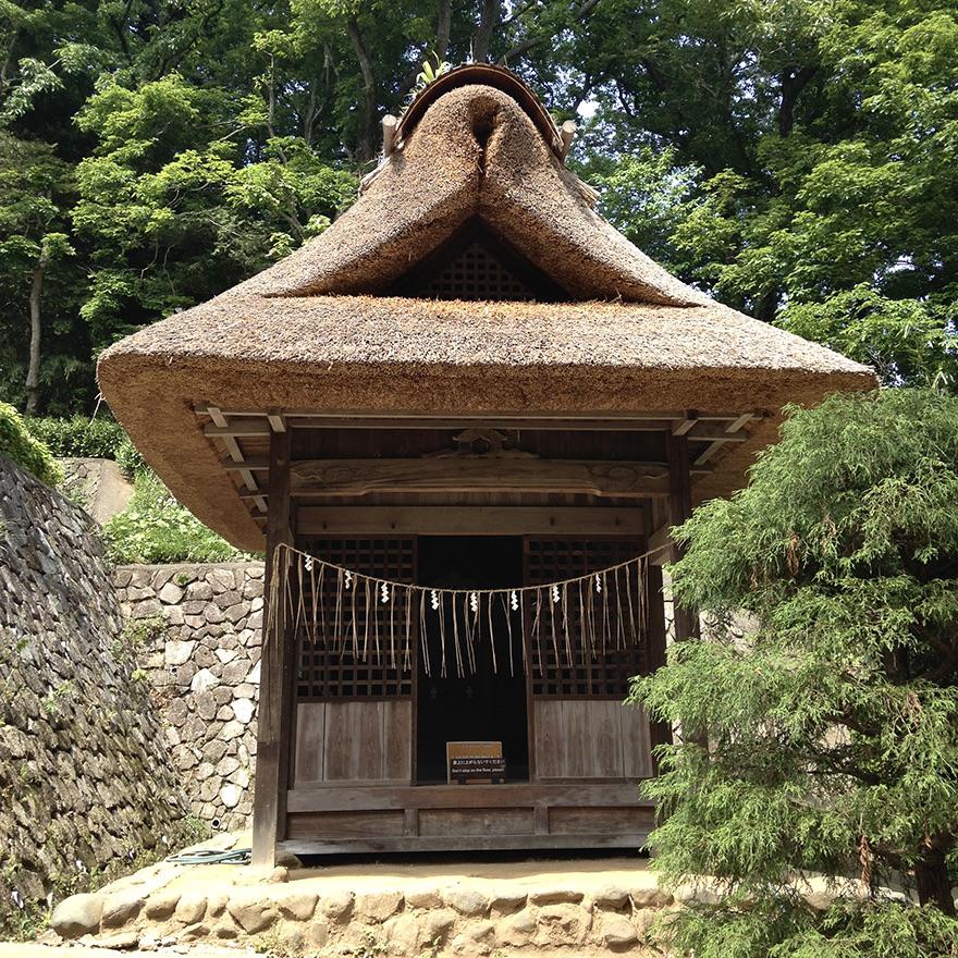 Thatch-roofed shrine at the Nihon Minka-en Japanese Folk House Garden