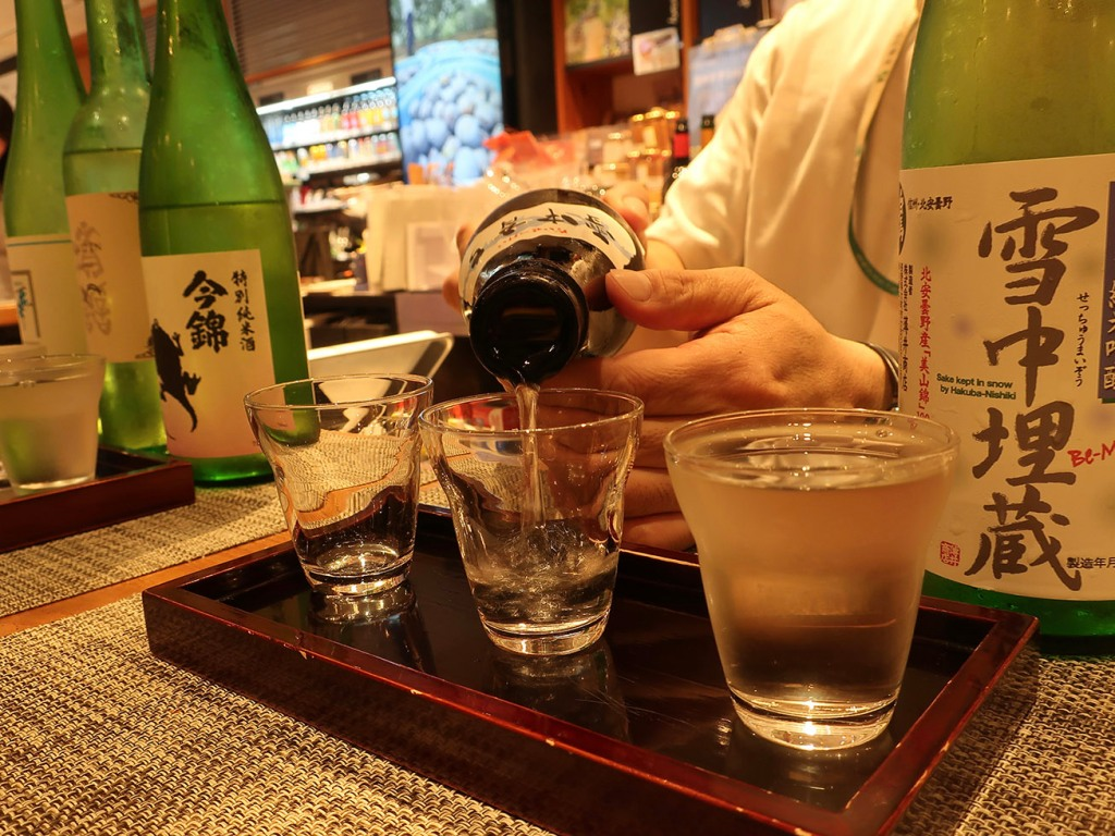 Pouring sake for a sake tasting