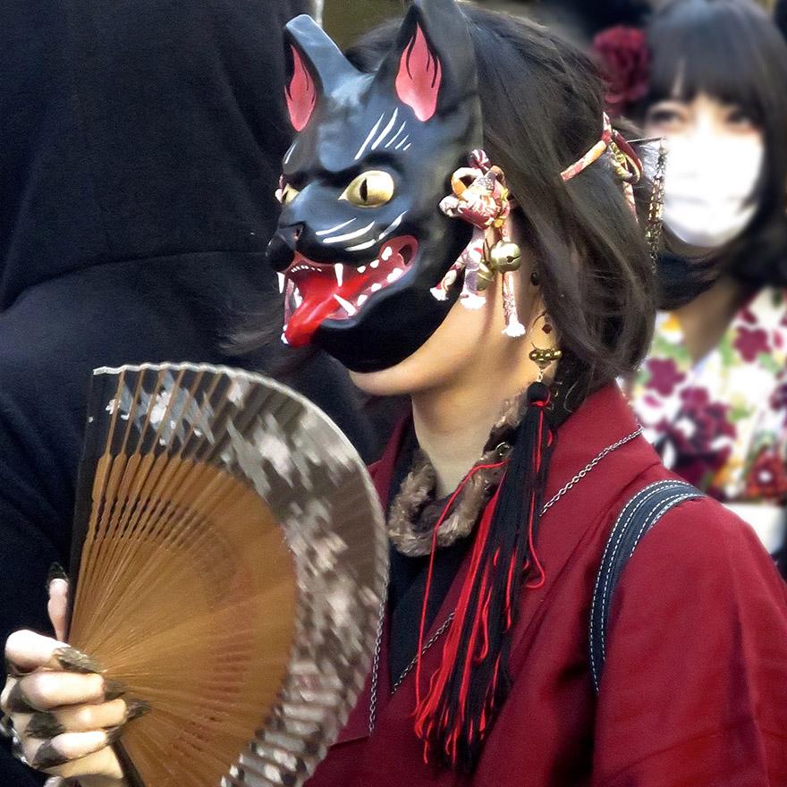 Someone dressed up in crazy ghost cat mask in the Bakeneko Parade in Kagurazaka