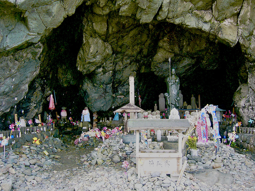 Jizo statues offered in a cave memorial for lost children on Sado Island