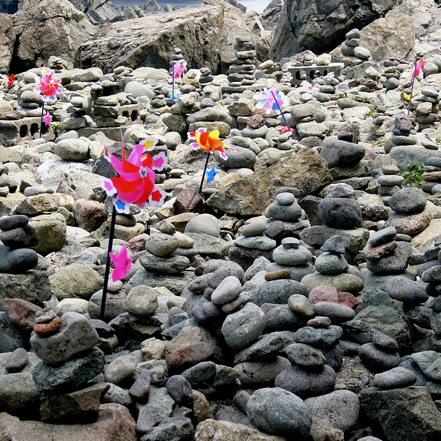 Stones piled in memorials for lost children on Sado Island